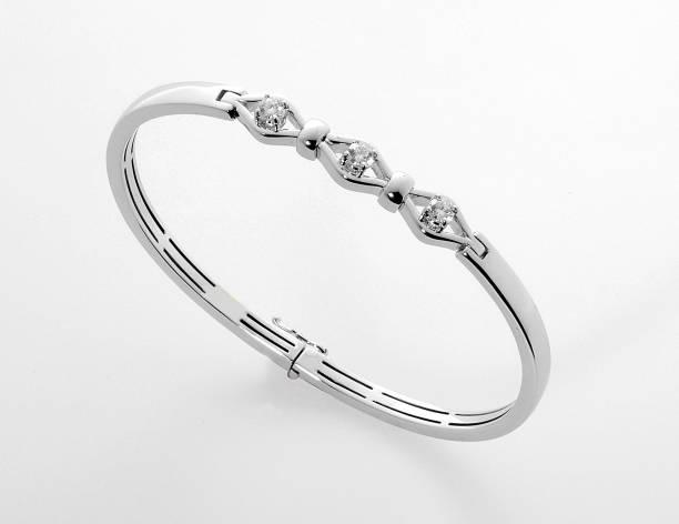 silver or platinum diamond bracelet or bangle - браслет стоковые фото и изображения