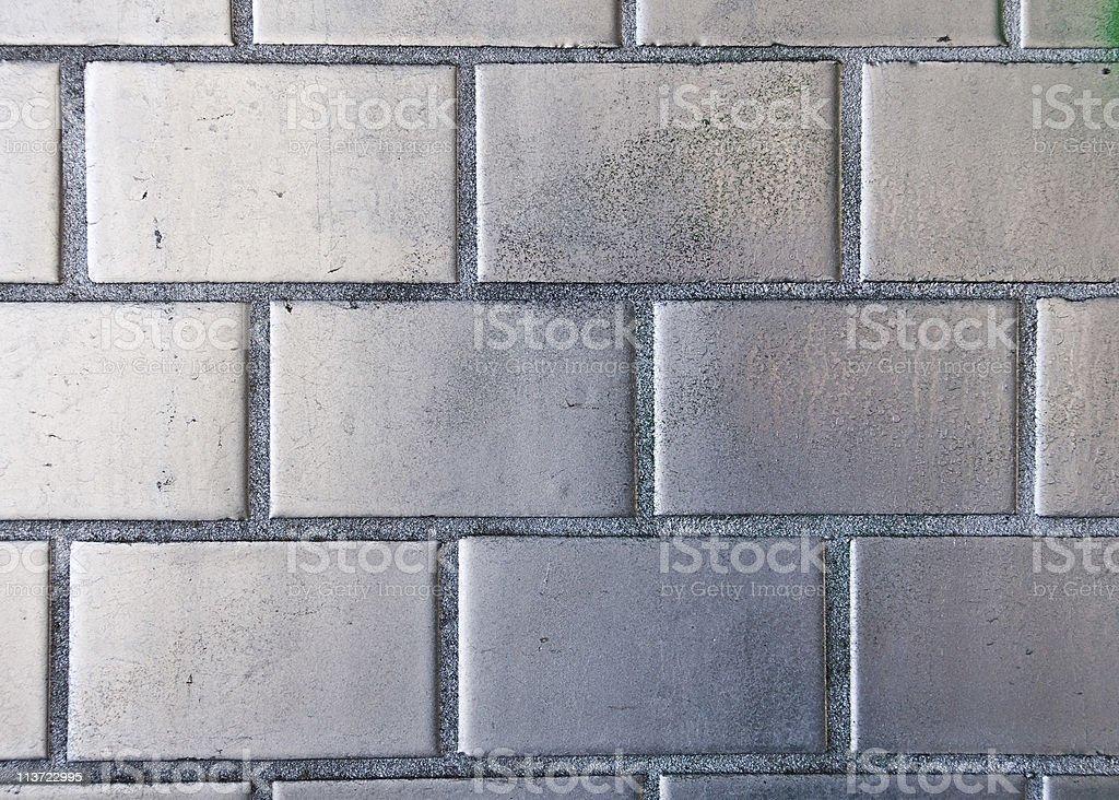 Silver painted brickwall stock photo