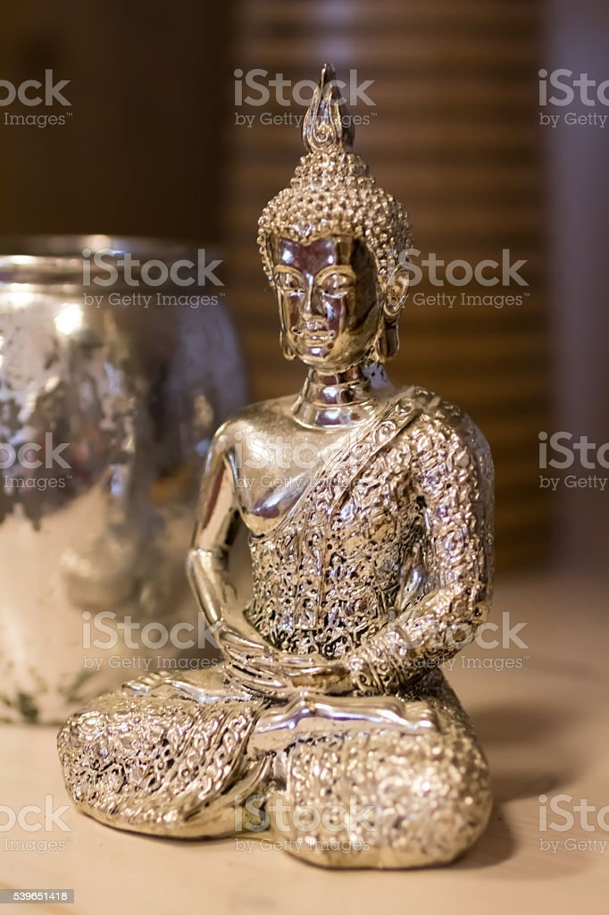 Silver painted Buddha figurine stock photo