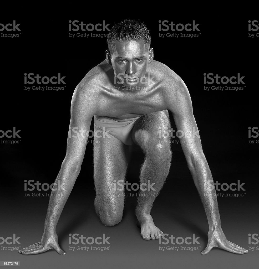 silver painted man on pole position stock photo
