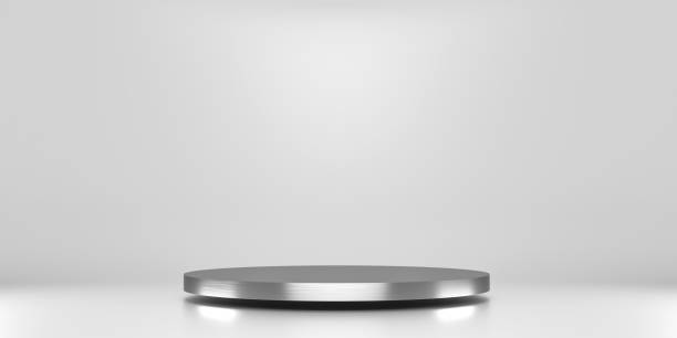 Silver pedestal of platform display with luxury stand podium on white room background. Blank Exhibition or empty product shelf. 3D rendering. stock photo