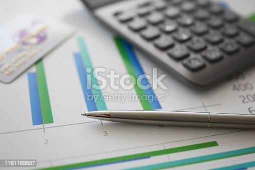 istock Silver pen gray calculator and credit plastic card 1161189857