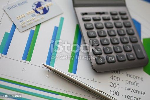 istock Silver pen gray calculator and credit plastic card 1161189863