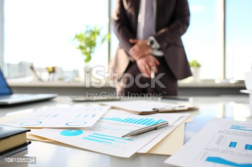 istock Silver pen lie at important paper on table in office 1061035234