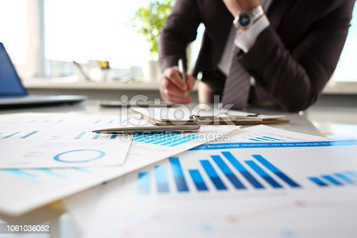 istock Silver pen lie at important paper on table in office 1061036052