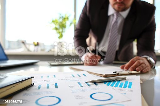 istock Silver pen lie at important paper on table in office 1061036276