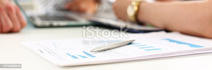 860389678 istock photo Silver pen lie at important paper on table 1070899948