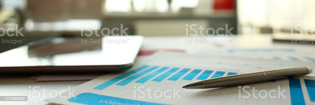 Silver pen lie at important paper on table stock photo