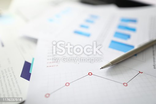 istock Silver pen lies on documents with 1176237518