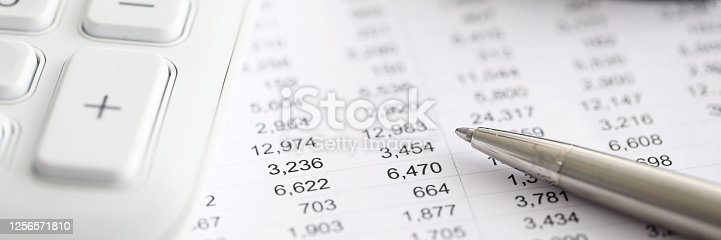 Silver pen report with numbers next to calculator. Range financial instruments for trading on currency exchange. Financial data analysis. Marketing tactics and business lead management
