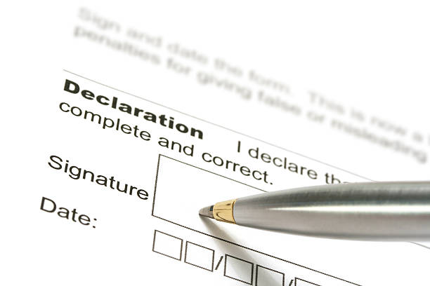 Silver pen signing a declaration stock photo