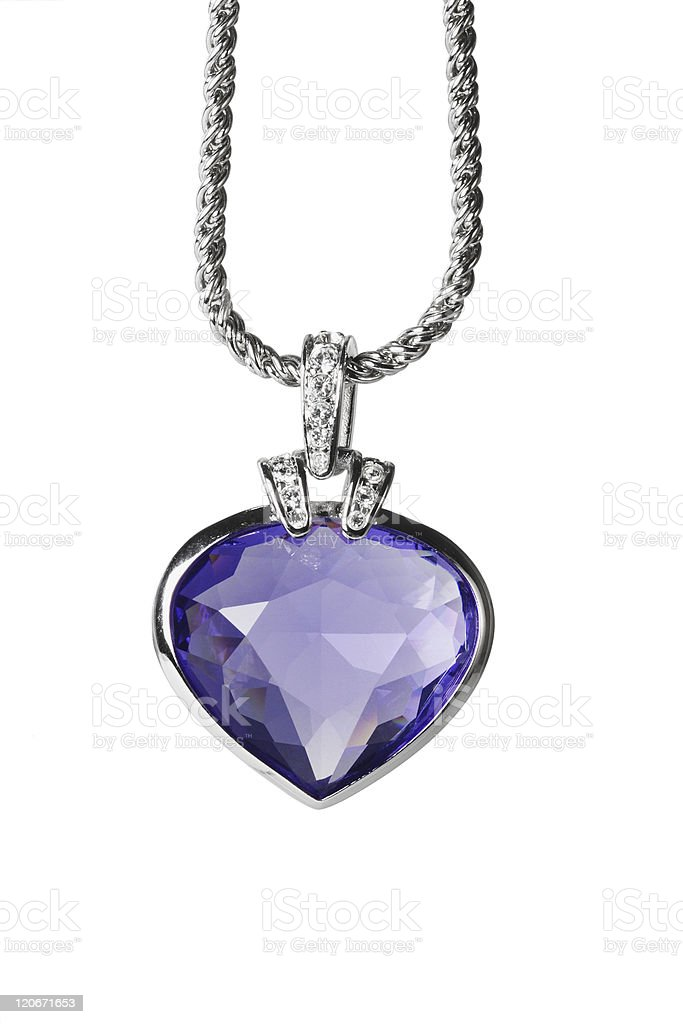 Silver pendant and blue heart shaped gemstone royalty-free stock photo
