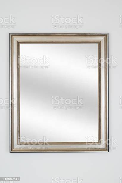 Picture frame in silver or pewter with digital mirror inserted, isolated on white background.