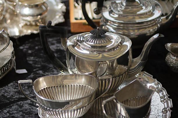 Silver plated teapot, milk jug and sugar bowl stock photo