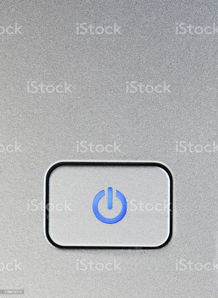 Silver power button close-up stock photo