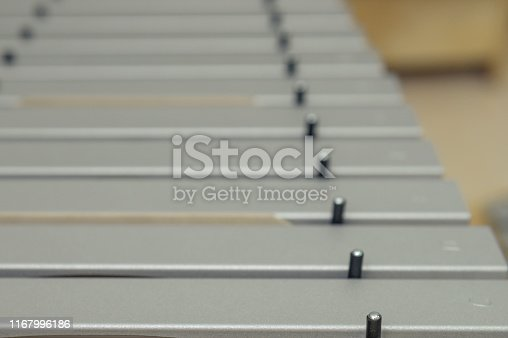 Silver practice keys from xylophone. closeup of xylophone seen from above