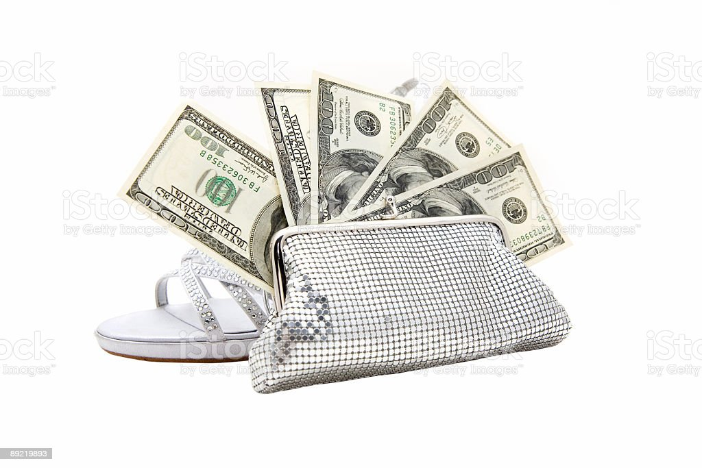 Silver purse stuffed with money royalty-free stock photo