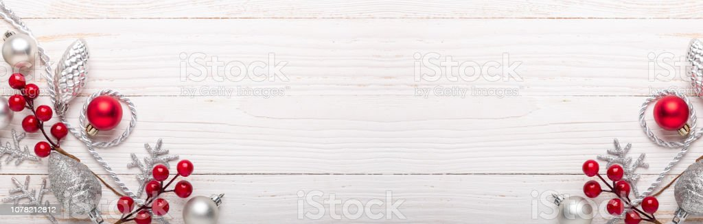 Silver and red christmas gifts on white wooden background. Top view....