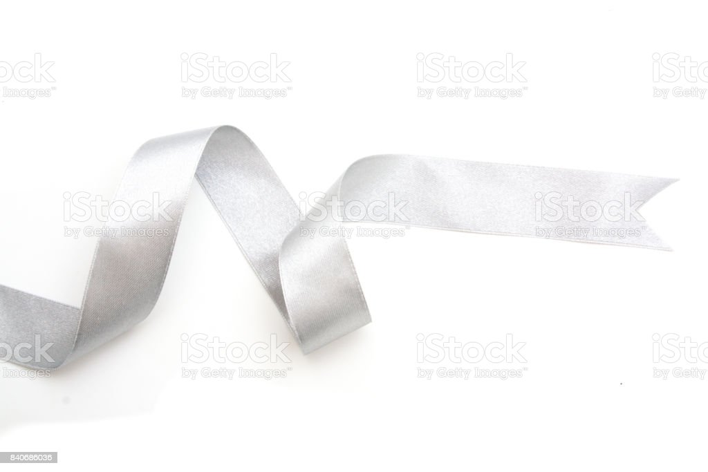 silver ribbon bow in bright silver white grey color isolated on white background stock photo