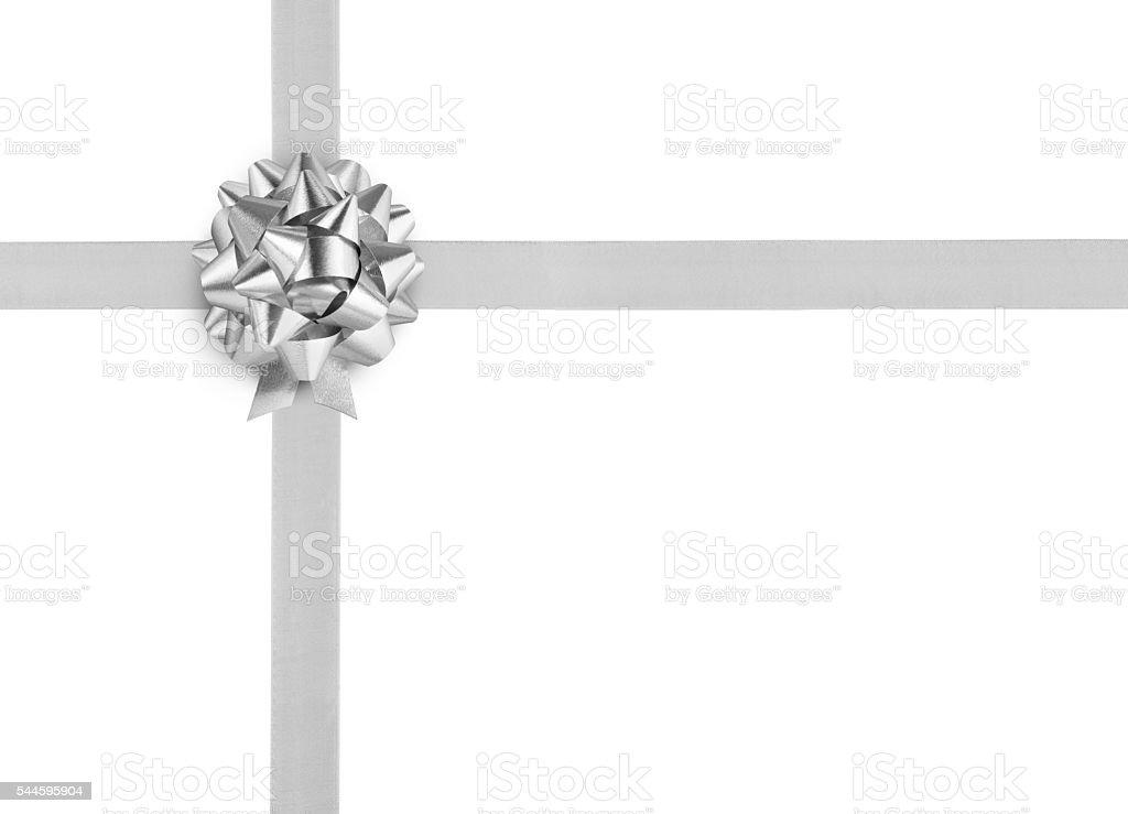 Silver ribbon bow on white background stock photo