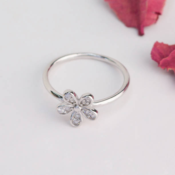 silver ring in the flower shape decorated with diamonds stock photo