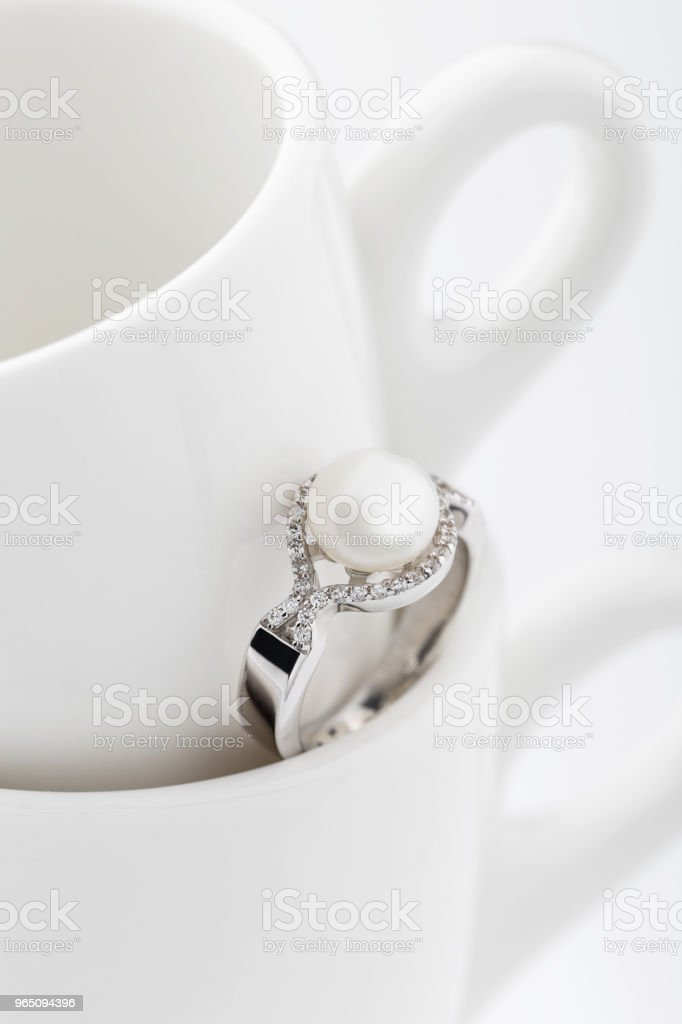 Silver ring with big pearl and diamonds royalty-free stock photo