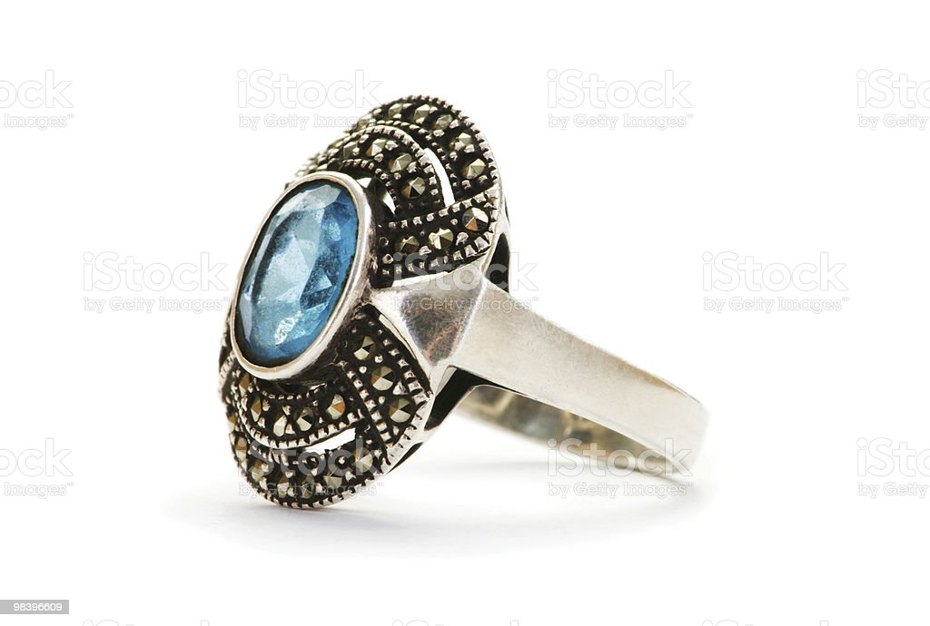 Silver ring with blue stone on white background royalty-free stock photo