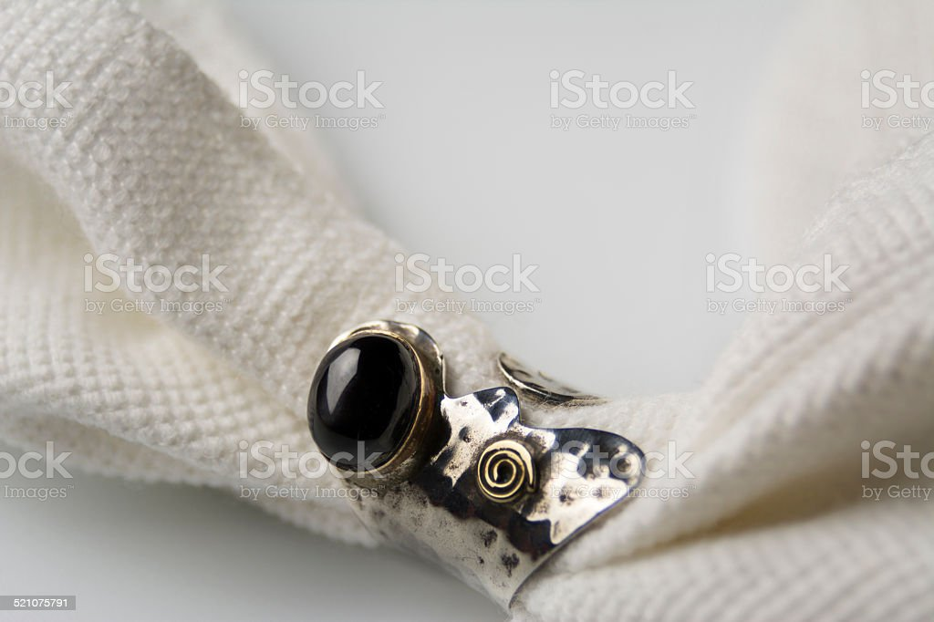 silver ring with onix black stone stock photo