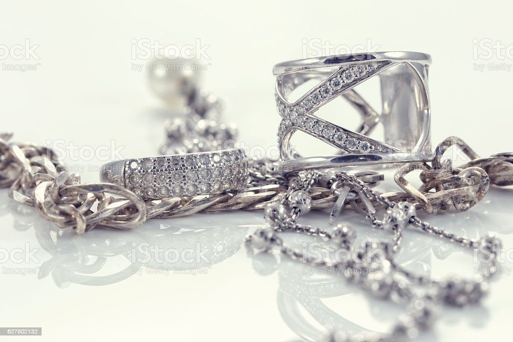 Silver ring with precious stones and fine silver chain stock photo