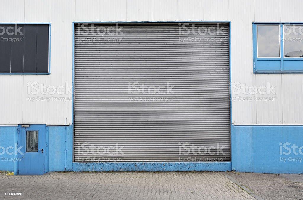 Rolling garage door of a factory building..