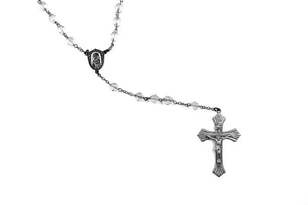 Silver Rosary Beads On White Holy Rosary Beads Isolated on White. Amen stock pictures, royalty-free photos & images