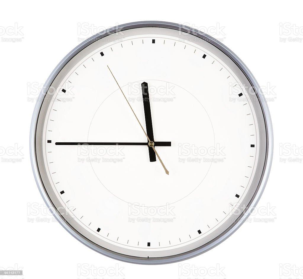 Silver Round Clock displaying 11:45 stock photo