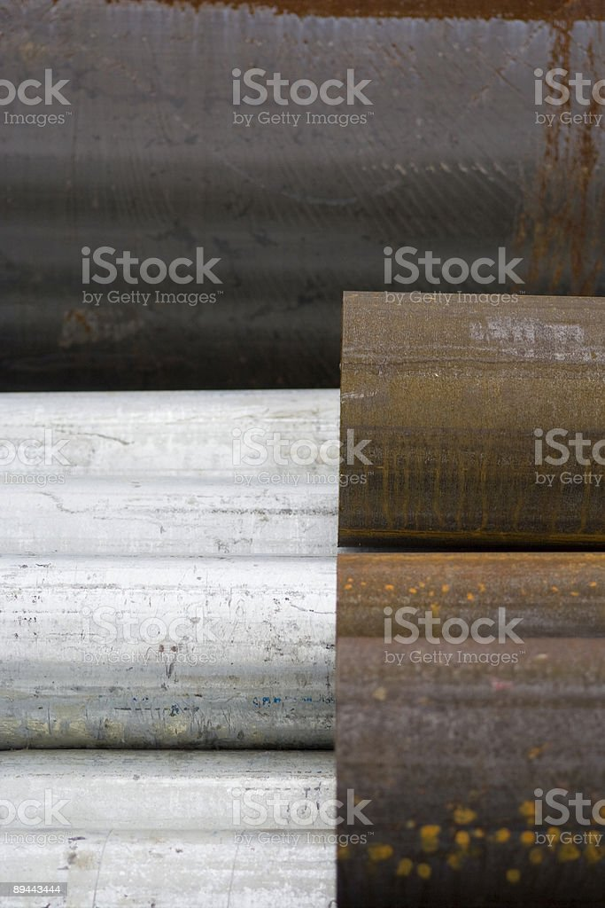 Silver, rust and black pipes royalty-free stock photo