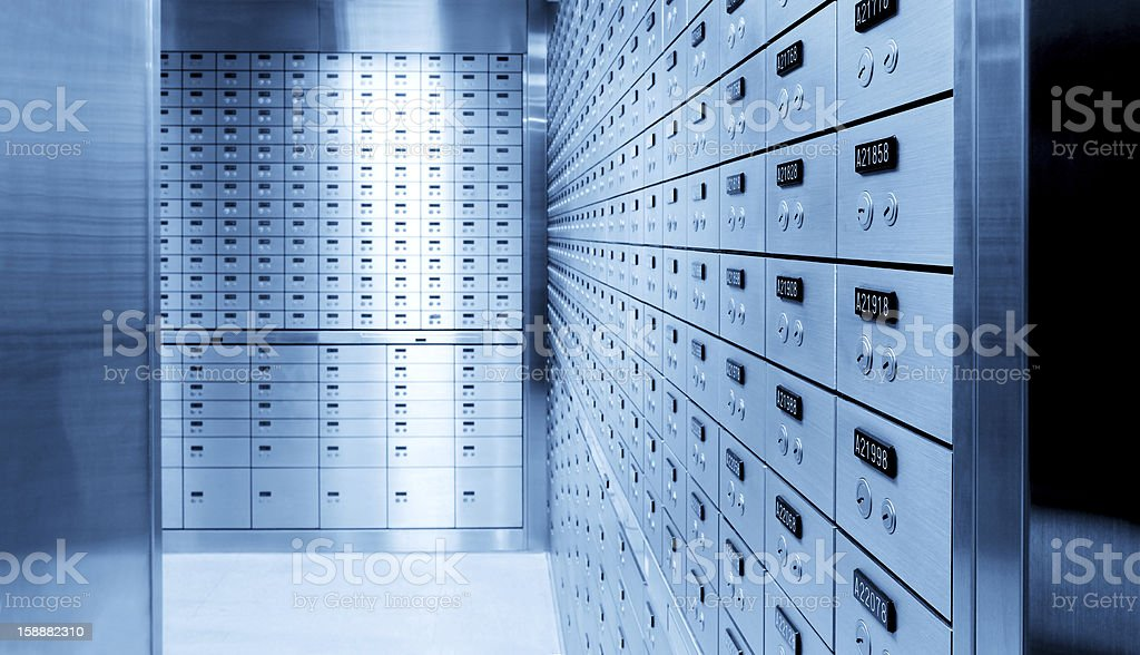 Silver safety deposit boxes in a safe bank stock photo