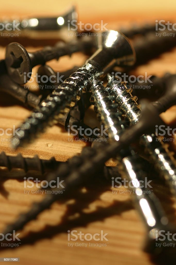 Silver Screw on a pile royalty-free stock photo