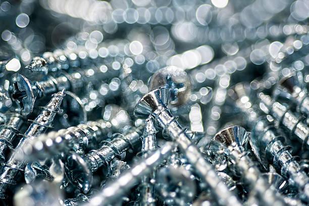 Silver Screws Macro Close Up. Background Pattern. stock photo