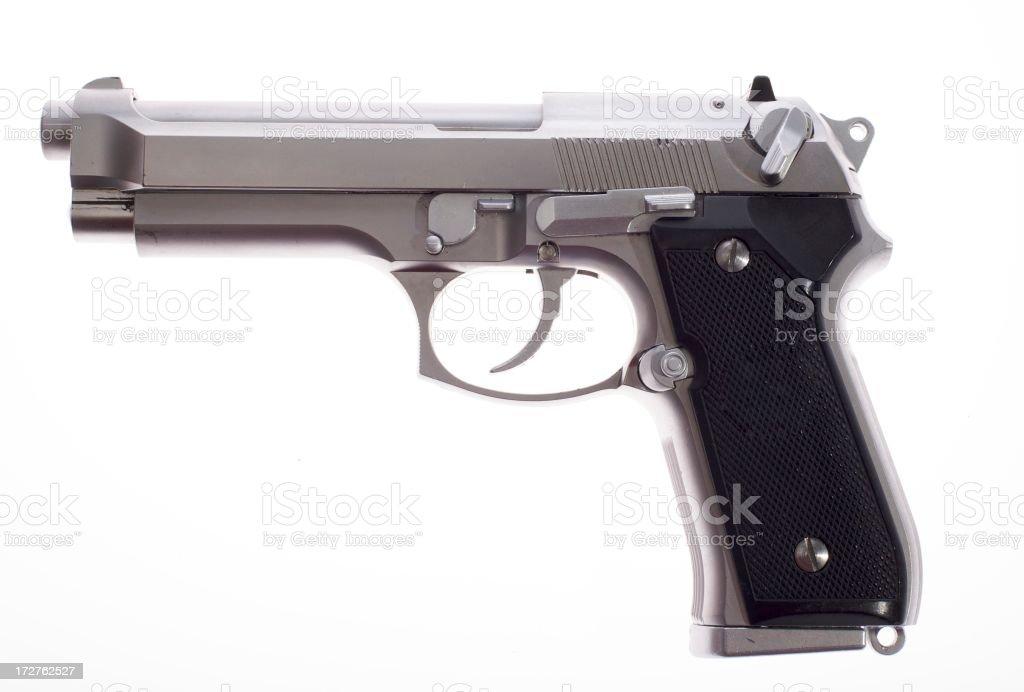 A silver semi auto handgun on white background royalty-free stock photo