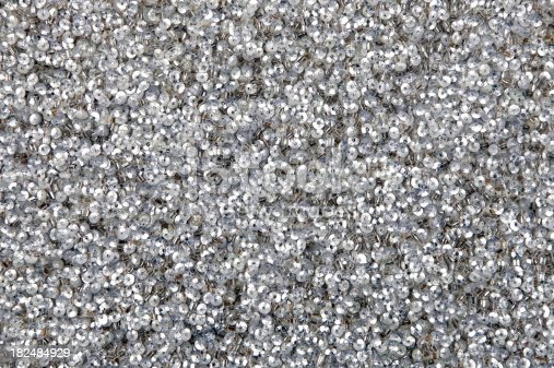 Shiny sparkle silver sequins great for texture or background.  Zoom in to see great detail!