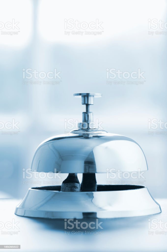 Silver service bell on a desk with copy space above stock photo