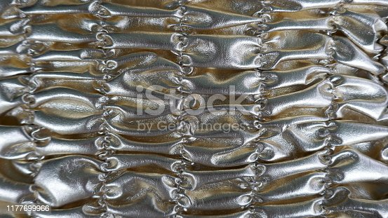 948081716 istock photo Silver  shiny  shirred fabric. Metallic texture, full frame background 1177699966