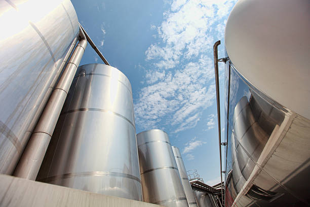 Silver silos and tank - industrial infrastructure stock photo