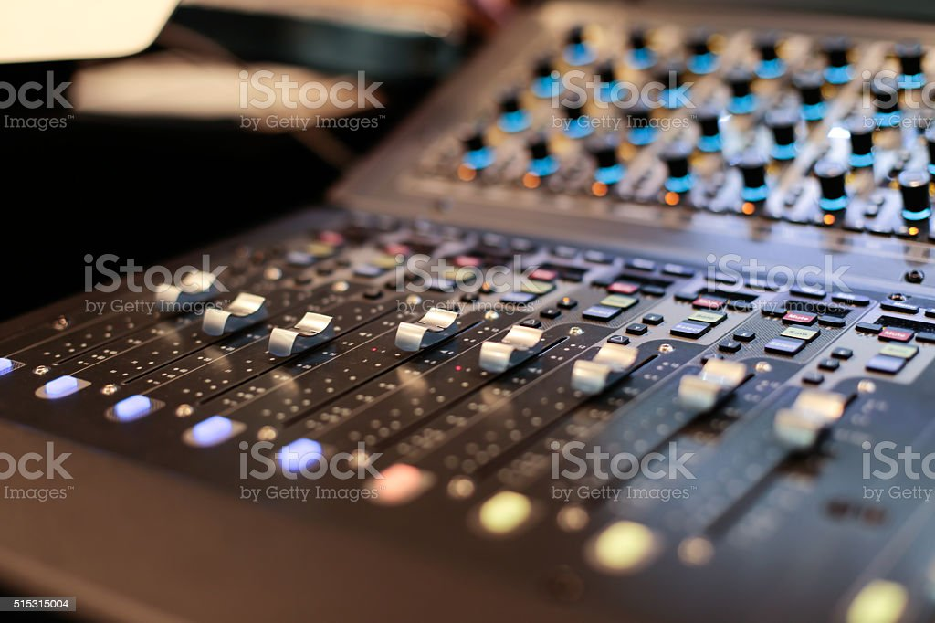 Silver sliders of the stage controller stock photo