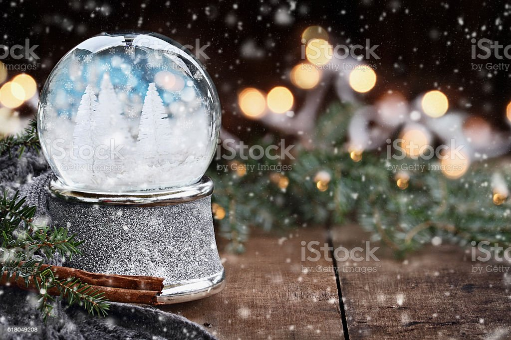Silver Snow Globe with White Christmas Trees stock photo