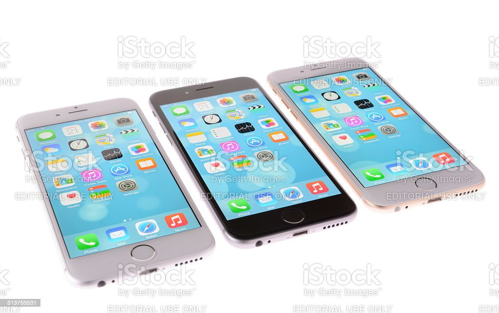 Silver, Space Gray and Gold iPhones on White Background stock photo