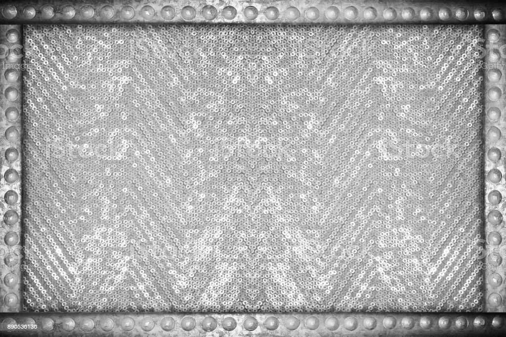 Silver sparkle glittering background with metal rivets frame stock photo