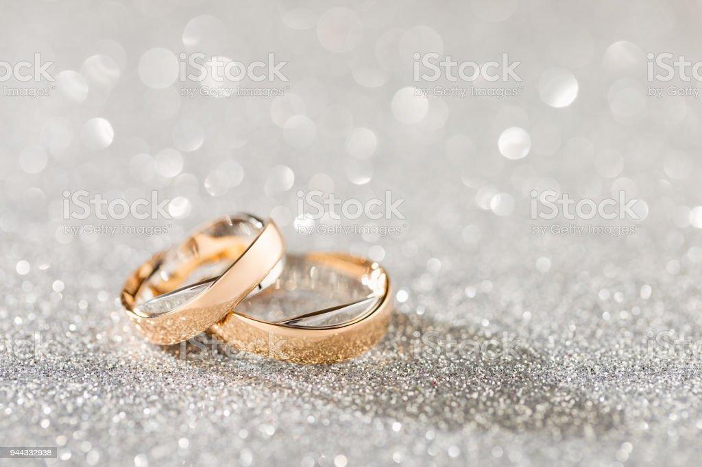 Silver Sparkling Glitter Bokeh Background With Golden Wedding
