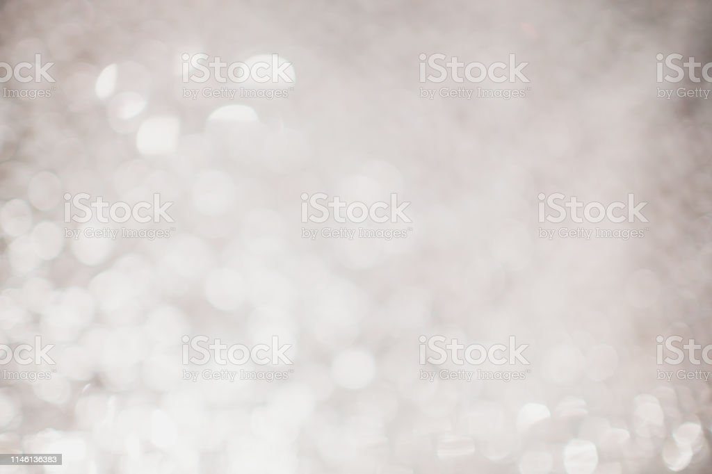 silver Sparkling Lights Festive background with texture. Abstract...
