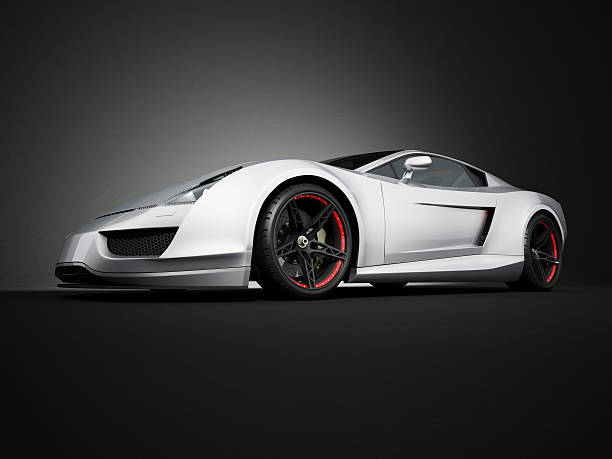 Silver sport car on black studio background This red sport car is a concept design is made by myself. Wheel and tyre style are concept design too. This super sport car comes without any manufacture brands but looks like a modern Ferrari or Lamborghini. The image is a CGI. exoticism stock pictures, royalty-free photos & images