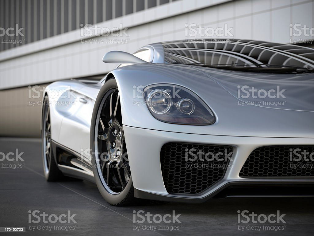 A silver sports car on black tile floor royalty-free stock photo