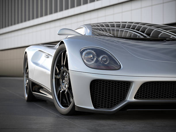 A silver sports car on black tile floor A moden silver sports car in front of a building. Unique and generic sports car design.  Designed and modelled entirely by myself. Very high resolution 3D render. All markings are ficticious. luxury car stock pictures, royalty-free photos & images